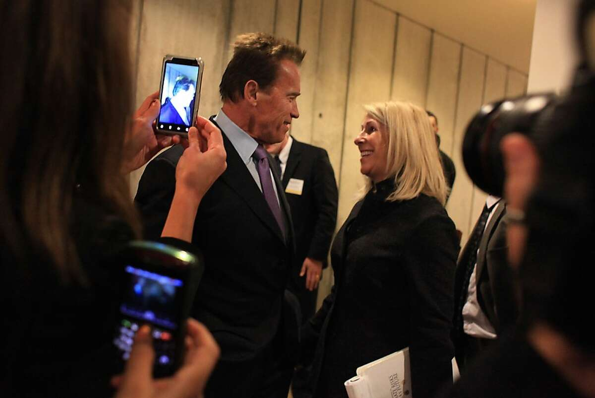 Former Governor Arnold Schwarzenegger talks with Nancy McFadden, Executive Secretary for Legislation, Appointments and Policy Office of Governor Jerry Brown before speaking at The Governor's Conference on Extreme Climate Risks and California's Future at the California Academy of Sciences in Golden Gate Park in 2011.