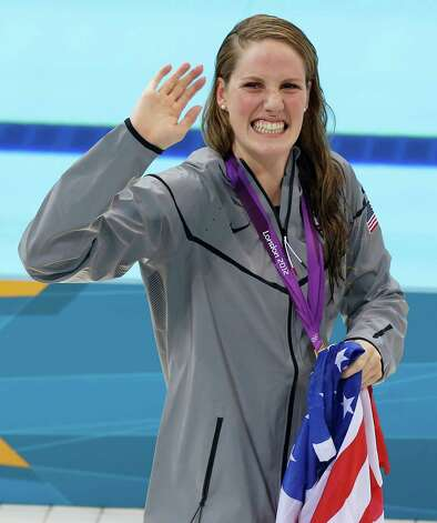 United States' gold medalist Missy Franklin holds a national flag as she celebrates her win in the women's 200-meter freestyle swimming semifinal  at the Aquatics Centre in the Olympic Park during the 2012 Summer Olympics in London, Monday, July 30, 2012. (AP Photo/Daniel Ochoa De Olza) Photo: Daniel Ochoa De Olza, Associated Press / AP