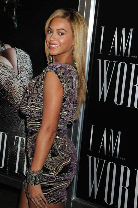 "Recording artist Beyonce Knowles arrives at a screening of her new DVD titled ""I AM...WORLD TOUR"" at the School of Visual Arts in New York on Sunday, Nov. 21, 2010.  (AP Photo/Darla Khazei) Photo: Darla Khazei / FR170456 AP"