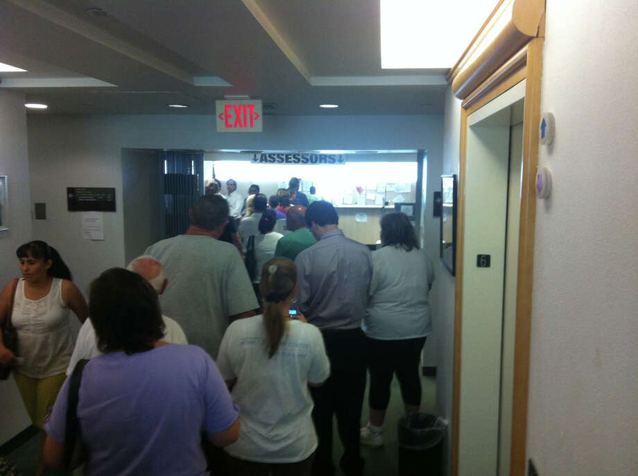 Stamford residents stand in line Monday at the tax office on the sixth floor of the government center. Taxes are due July 1 but residents have 30 days to pay before penalties kick in, and lines typically grow to 50 people and more in the final days of July. Photo: Kate King