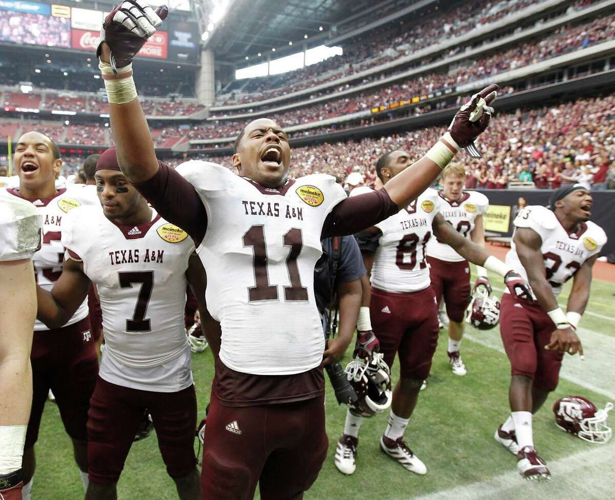 Texas A&M Aggies linebacker Jonathan Stewart (11) celebrates after the Meineke Car Care Bowl at Reliant Stadium,Saturday, Dec. 31, 2011, in Houston. Texas A&M won the game against Northwestern University 33-22.