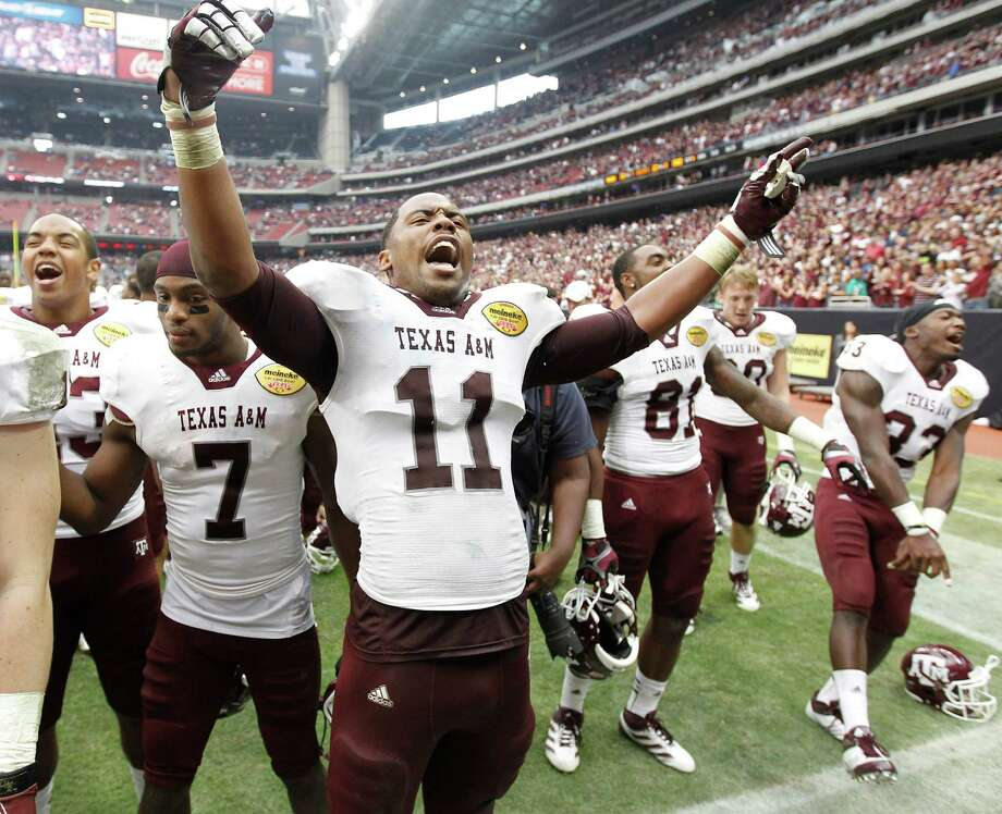Texas A&M Aggies linebacker Jonathan Stewart (11) celebrates after the Meineke Car Care Bowl at Reliant Stadium,Saturday, Dec. 31, 2011, in Houston.  Texas A&M won the game against Northwestern University 33-22. Photo: Karen Warren, Houston Chronicle / © 2011 Houston Chronicle