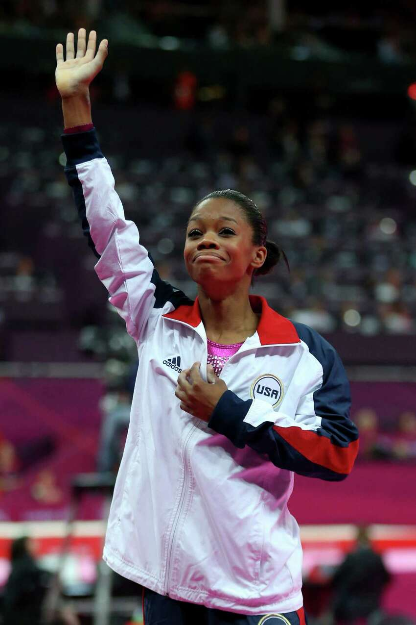 LONDON, ENGLAND - AUGUST 02: Gabrielle Douglas of the United States waves to the crowd after Douglas wins the gold medal in the Artistic Gymnastics Women's Individual All-Around final on Day 6 of the London 2012 Olympic Games at North Greenwich Arena on August 2, 2012 in London, England. (Photo by Streeter Lecka/Getty Images)