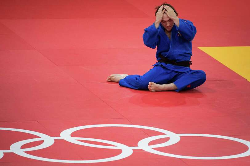 Kyle Vashkulat of the USA reacts after he lost his opening bout in the 100kg judo competition to Ram