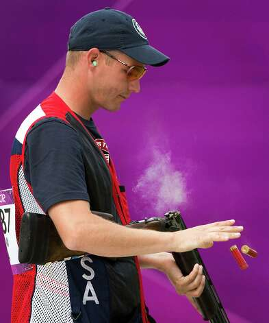Glenn Eller ejects shells from his gun as he competes in the men's double trap qualification at the 2012 London Olympics on Thursday, Aug. 2, 2012. Photo: Smiley N. Pool, Houston Chronicle / © 2012  Houston Chronicle