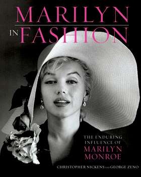 """This book cover image released by Running Press, a member of the Perseus Books Group, shows """"Marilyn in Fashion: The enduring Influence of Marilyn Monroe,"""" by Christopher Nickens and George Zeno. (AP Photo/Running Press, a member of the Perseus Books Group) (Associated Press)"""