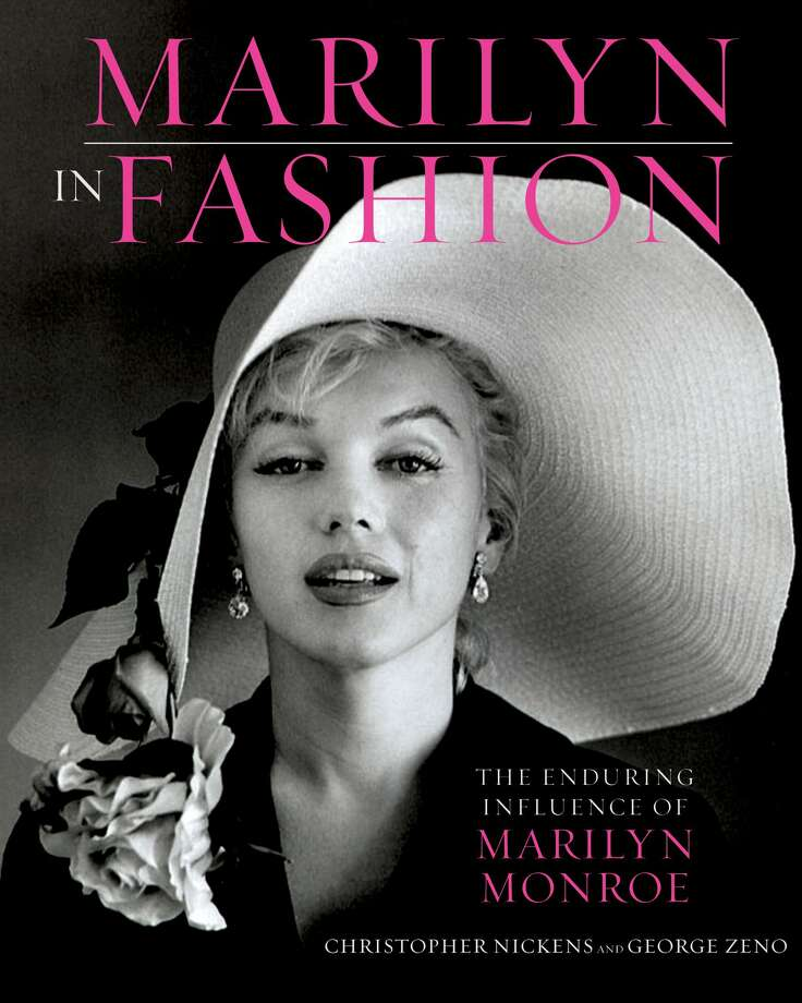 "This book cover image released by Running Press, a member of the Perseus Books Group, shows ""Marilyn in Fashion: The enduring Influence of Marilyn Monroe,"" by Christopher Nickens and George Zeno. (AP Photo/Running Press, a member of the Perseus Books Group) (Associated Press)"
