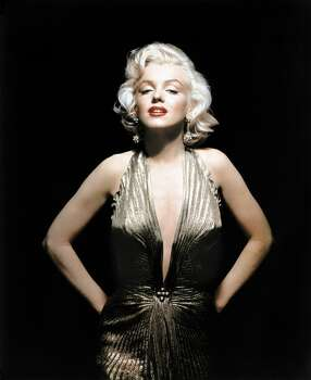 """Marilyn Monroe is sultry in William Travilla's gold lame knife-pleated gown with a halter neckline and style lines that are somewhat Egyptian. She wore it for a scene in """"Gentlemen Prefer Blondes,"""" but is only seen from the rear in the moive. The gown is well known to Monroe fans because she wore it for a series of color portraits that are among her most famous. (Reprinted with permission from t)"""
