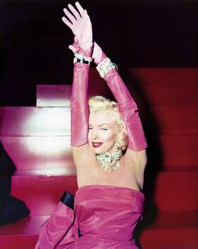 """As  Lorelei Lee, Marilyn Monroe poses on the set of """"Gentlemen Prefer Blondes,"""" in the midst of filming """"Diamonds Are a Girl's Best Friend"""" in William Travilla's floor-length strapless gown. (Reprinted with permission from t)"""