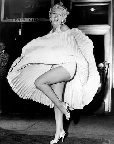 """In this September 15, 1954 publicity photo courtesy Running Press, Marilyn Monroe is shown during the """"subway"""" scene of """"The Seven Year Itch,"""" filmed late in the evening on Lexington Avenue in New York."""
