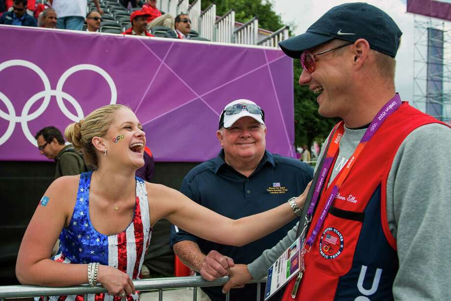 Glenn Eller, right, gets some support from friend Shelby Searcy of Houston, left, and his uncle Mike Sullivan, before his final round of shooting as he competes in the men's double trap qualification at the 2012 London Olympics on Thursday, Aug. 2, 2012. Photo: Smiley N. Pool, Houston Chronicle / © 2012  Houston Chronicle