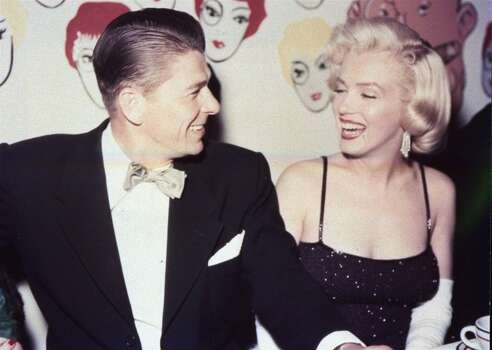 Ronald Reagan shares a laugh with Marilyn Monroe in Los Angeles in this 1959 file photo. Reagan, the cheerful crusader who devoted his presidency to winning the Cold War, trying to scale back government and making people believe it was ``morning again in America,'' died Saturday, June 5, 2004, after a long twilight struggle with Alzheimer's disease. (AP Photo/HO, File) (AP)