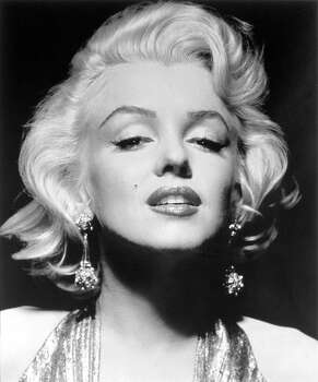 """This photograph released by the Brooklyn Museum of Art, titled """"Marilyn Monroe, 1953"""" is part of show opening at the museum Friday, Nov. 12, 2004. The black and white photograph by Gene Kornman is one of more than 200 Monroe pictures from 39 photographers - including luminaries such as Richard Avedon, Gordon Parks, Robert Frank and Andy Warhol - in the museum's new exhibit, """"I Want to Be Loved by You: Photographs of Marilyn Monroe."""" (AP Photo/Brooklyn Museum of Art, Gene Kornman) (GENE KORNMAN / AP)"""