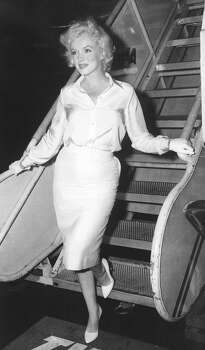 """FILE - In this July 7, 1958 file photo, actress Marilyn Monroe leaves New York by air for Hollywood, to start work on """"Some Like It Hot,"""" her first film in two years. (AP Photo, File) (Anonymous / Associated Press)"""