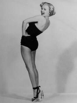 FILE - In this undated file photo, actress Marilyn Monroe is pictured mimicking Betty Grable's famous World War II pin-up pose. (AP Photo, File) (Associated Press)