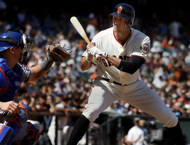 New Giants outfielder Hunter Pence looked back Rob Johnson of the Mets after a close call. The San Francisco Giants lost to the New York Mets on the final of a four game series Thursday August 2, 2012 at AT&T park. Photo: Brant Ward, The Chronicle