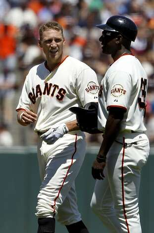 New Giant Hunter Pence (left) talks with first base coach Roberto Kelly after flying out. The San Francisco Giants lost to the New York Mets on the final of a four game series Thursday August 2, 2012 at AT&T park. Photo: Brant Ward, The Chronicle