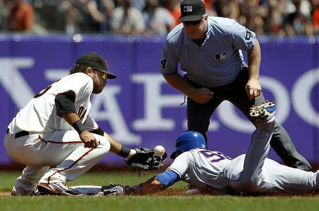 Andres Torres slides into second with a double his ex-teammates might envy. Photo: Brant Ward, The Chronicle