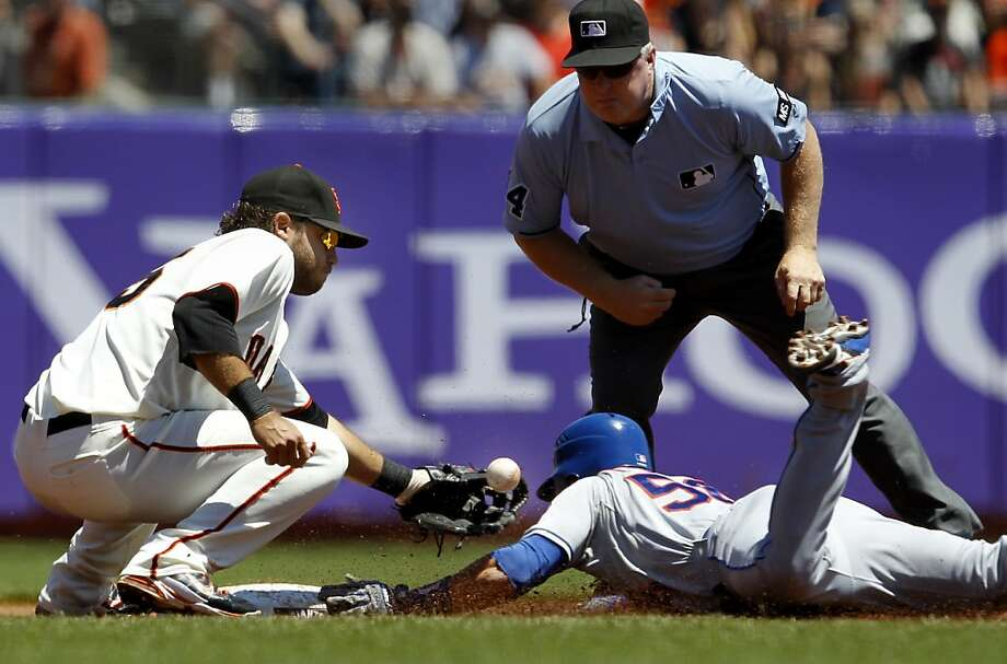 In the second inning, former Giant Andres Torres slid into second with a double as Brandon Crawford didn't hold onto the ball. The San Francisco Giants lost to the New York Mets on the final of a four game series Thursday August 2, 2012 at AT&T park. Photo: Brant Ward, The Chronicle