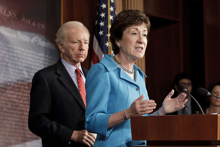 Sen. Susan Collins, R-Maine, the ranking member of the Senate Homeland Security Committee, right, accompanied by the committee's Chairman Sen. Joseph Lieberman, I-Conn., gestures during a news conference on Capitol Hill in Washington, Tuesday, July 24, 2012, to announce that the Senate will take up legislation later this week to protect critical U.S. industries and other corporate networks from cyberattacks and electronic espionage. (AP Photo/J. Scott Applewhite) Photo: J. Scott Applewhite, Associated Press