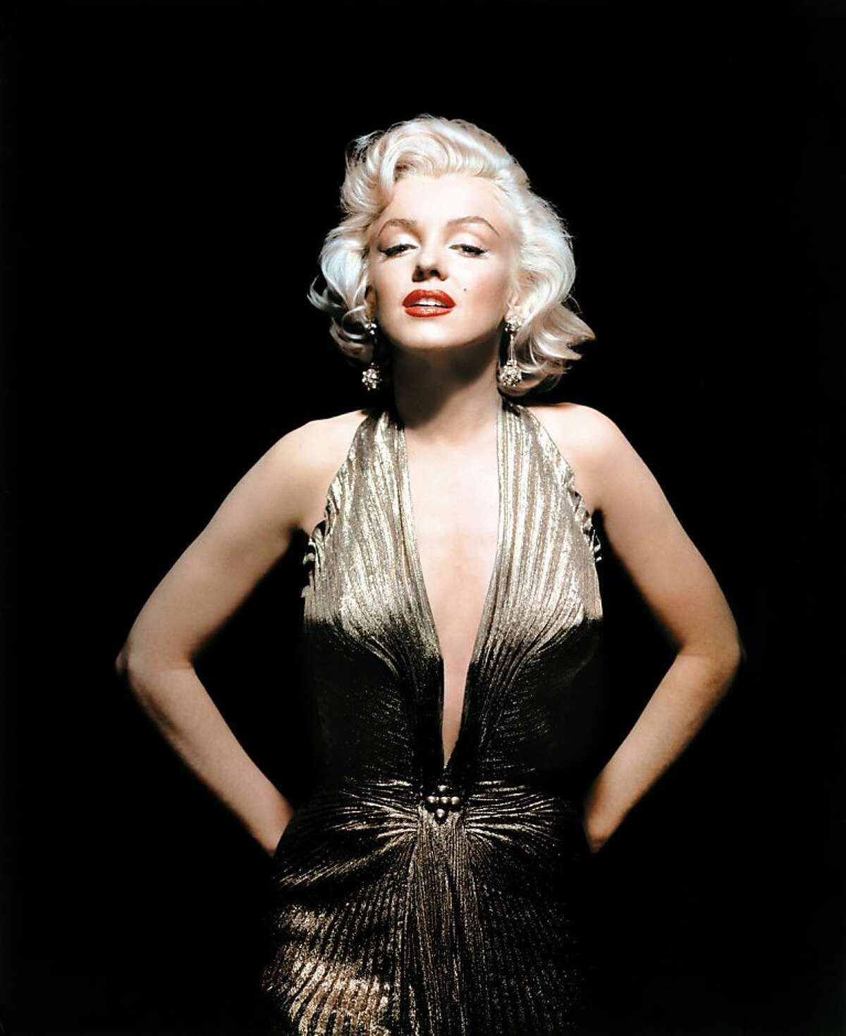 In this undated publicity photo courtesy Running Press, Marilyn Monroe is shown wearing a knife-pleated gold lamé gown made from