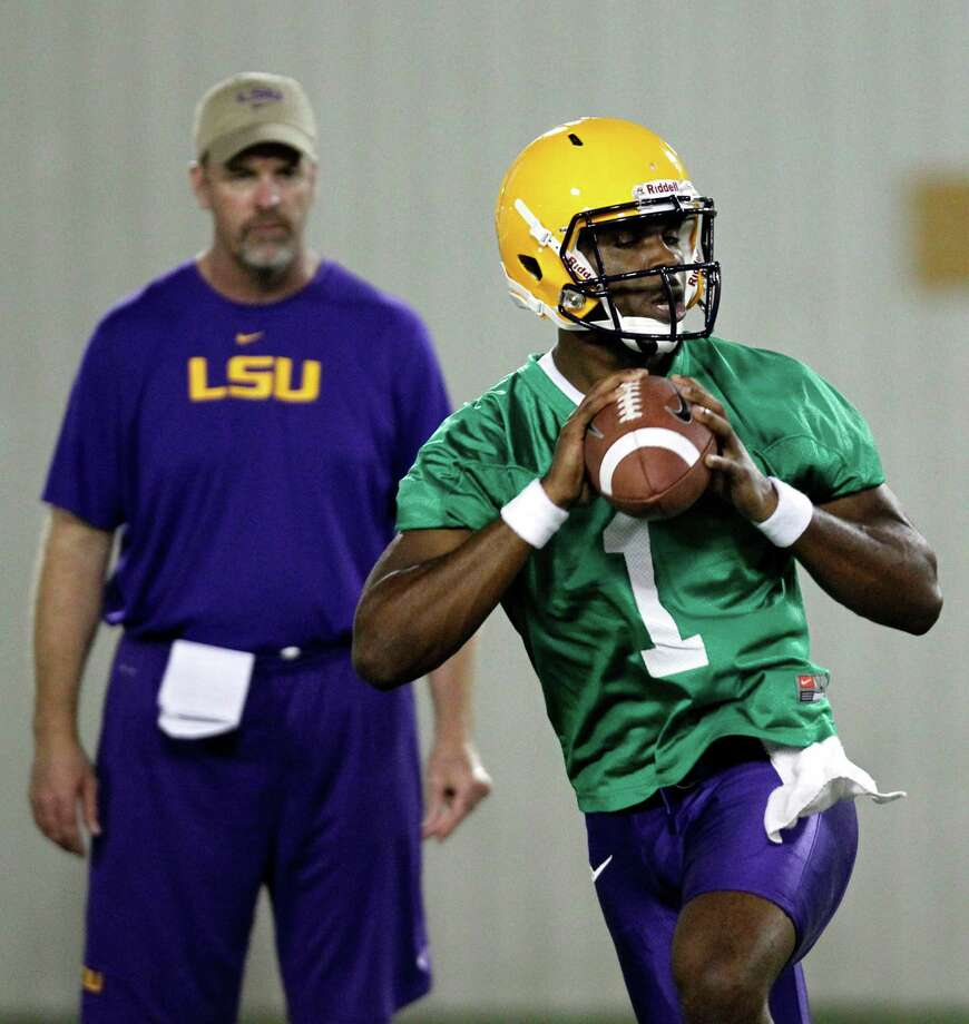 LSU quarterback  Rob Bolden (1), who transferred from Penn State, works out on the first day of the Tigers' camp. Photo: Gerald Herbert, Associated Press / AP