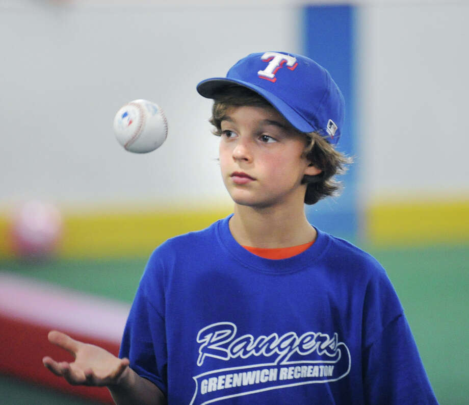 Alex Kral, 9, of the Rangers, during the Greenwich Parks and Recreation Department's Summer Baseball All-Star Challenge at Hamill Rink and the Byram Baseball Field, Thursday night, Aug. 2, 2012. Photo: Bob Luckey / Greenwich Time
