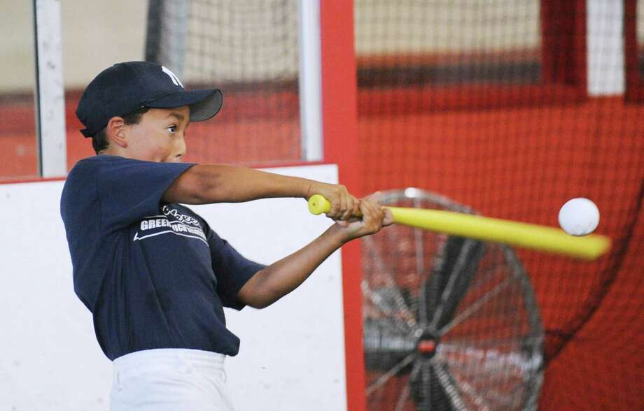 Alex Ramirez, 10, of the Yankees, bats in the home run derby during the Greenwich Parks and Recreation Department's Summer Baseball All-Star Challenge at Hamill Rink and the Byram Baseball Field, Thursday night, Aug. 2, 2012. Photo: Bob Luckey / Greenwich Time