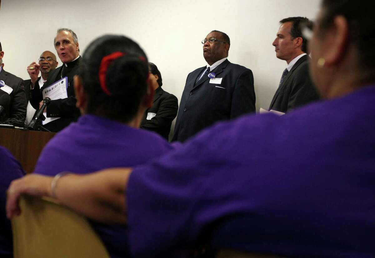 Cardinal Daniel DiNardo speaks during a news conference by area clergy to express their support for janitors seeking higher wages but urging them to not seek arrest while demonstrating.