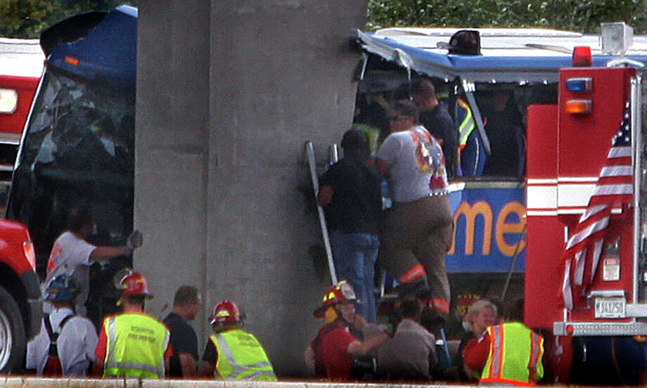 First responders work at the crash on I-55 near Litchfield, Ill. A blown tire might have caused the accident. Photo: David Spencer / The State Journal-Register