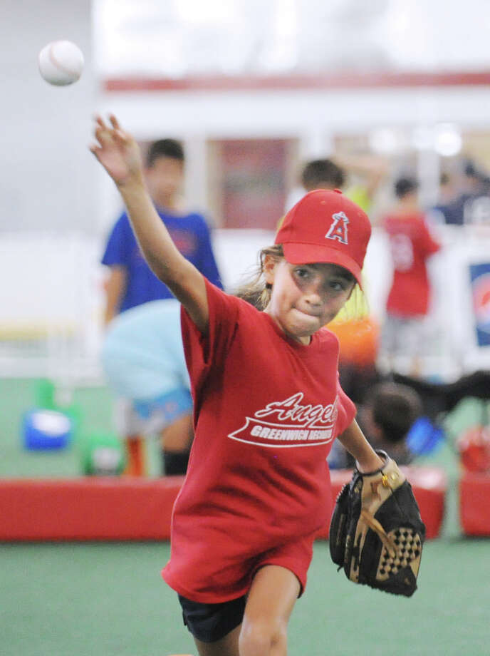 Camila Jablonski, 8, of the Angels, pitches during the Greenwich Parks and Recreation Department's Summer Baseball All-Star Challenge at Dorothy Hamill Skating Rink and the Byram Baseball Field, Thursday night, Aug. 2, 2012. Photo: Bob Luckey / Greenwich Time