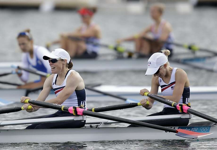 U.S rowers Julie Nichols, left, and Kristin Hedstrom sit in their boat after failing to qualify to the final during a lightweight women's rowing double sculls semifinal in Eton Dorney, near Windsor, England, at the 2012 Summer Olympics, Thursday, Aug. 2, 2012. (AP Photo/Natacha Pisarenko) Photo: Natacha Pisarenko, Associated Press