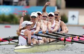 LONDON, ENGLAND - AUGUST 02:  Mary Whipple, Caryn Davies, Caroline Lind, Eleanor Logan, Meghan Musnicki, Taylor Ritzel, Esther Lofgren, Zsuzsanna Francia, and Erin Cafaro of the United States celebrate after winning the gold medal for the  Women's Eight rowing on Day 6 of the London 2012 Olympic Games at Eton Dorney on August 2, 2012 in Windsor, England.  (Photo by Armando Franca - IOPP Pool /Getty Images)