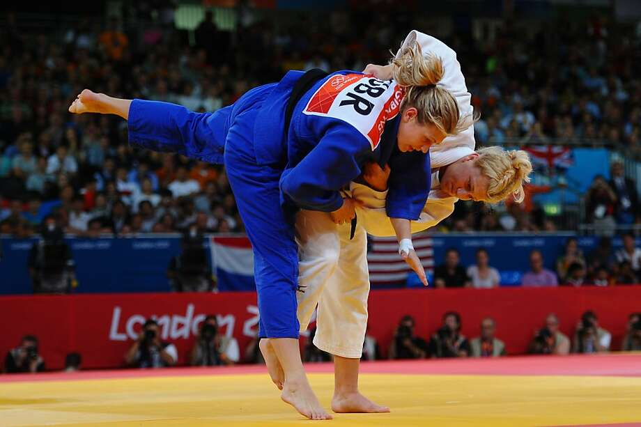 LONDON, ENGLAND - AUGUST 02:  Kayla Harrison of the United States (white) and Gemma Gibbons of Great Britain compete in the Women's -78 kg Judo on Day 6 of the London 2012 Olympic Games at ExCeL on August 2, 2012 in London, England.  (Photo by Laurence Griffiths/Getty Images) Photo: Laurence Griffiths, Getty Images