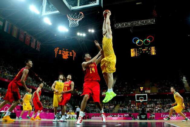Aron Baynes #12 of Australia goes up for a slam dunk against Zhizhi Wang #14 of China in the first half during the Men's Basketball Preliminary Round match on Day 6 of the London 2012 Olympic Games at Basketball Arena on August 2, 2012 in London, England. (Christian Petersen / Getty Images)