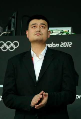 Retired NBA basketball player Yao Ming cheers during the game between China and Australia during the Men's Basketball Preliminary Round match on Day 6 of the London 2012 Olympic Games at Basketball Arena on August 2, 2012 in London, England. (Christian Petersen / Getty Images)