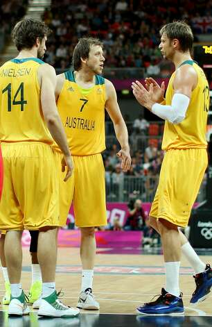 Joe Ingles #7 of Australia talks with teammates Matt Nielsen #14 and David Andersen #13 after scoring two points and drawing a foul in the first half against China during the Men's Basketball Preliminary Round match on Day 6 of the London 2012 Olympic Games at Basketball Arena on August 2, 2012 in London, England. (Christian Petersen / Getty Images)