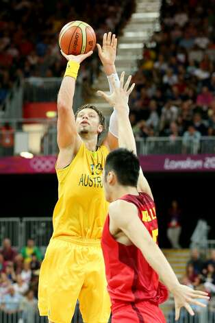 David Andersen #13 of Australia shoots a three-point shot against Zhaoxu Zhang #10 of China in the first half during the Men's Basketball Preliminary Round match on Day 6 of the London 2012 Olympic Games at Basketball Arena on August 2, 2012 in London, England. (Christian Petersen / Getty Images)