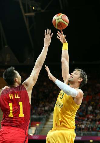 David Andersen #13 of Australia shoots against Jianlian Yi #11 of China in the first half during the Men's Basketball Preliminary Round match on Day 6 of the London 2012 Olympic Games at Basketball Arena on August 2, 2012 in London, England. (Christian Petersen / Getty Images)
