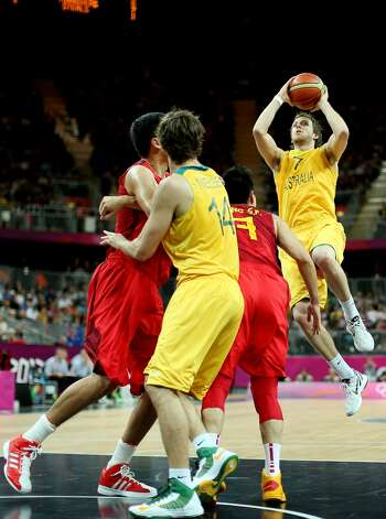 Joe Ingles #7 of Australia shoots against Shipeng Wang #7 of China in the first half during the Men's Basketball Preliminary Round match on Day 6 of the London 2012 Olympic Games at Basketball Arena on August 2, 2012 in London, England. (Christian Petersen / Getty Images)