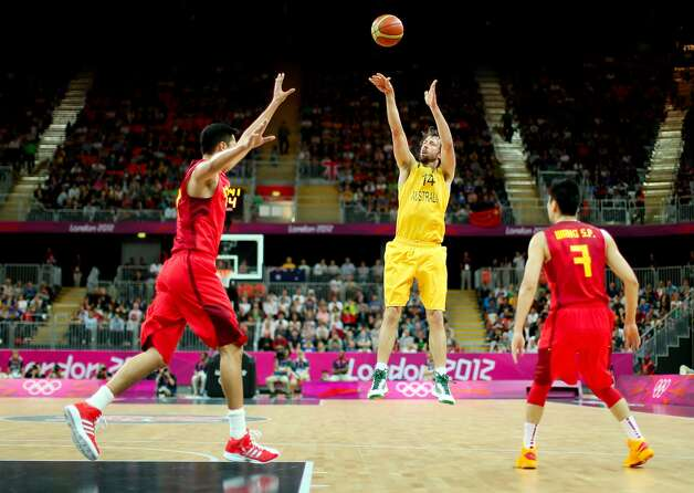 Matt Nielsen #14 of Australia shoots a jump shot against Zhizhi Wang #14 of China and Shipeng Wang #7 of China in the first half during the Men's Basketball Preliminary Round match on Day 6 of the London 2012 Olympic Games at Basketball Arena on August 2, 2012 in London, England. (Christian Petersen / Getty Images)