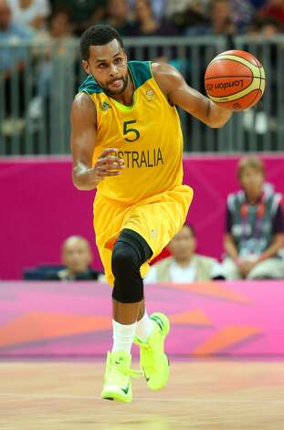 Patrick Mills #5 of Australia drives against China in the first half during the Men's Basketball Preliminary Round match on Day 6 of the London 2012 Olympic Games at Basketball Arena on August 2, 2012 in London, England. (Christian Petersen / Getty Images)