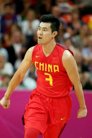 Shipeng Wang #7 of China reacts against Australia in the first half during the Men's Basketball Preliminary Round match on Day 6 of the London 2012 Olympic Games at Basketball Arena on August 2, 2012 in London, England. (Christian Petersen / Getty Images)