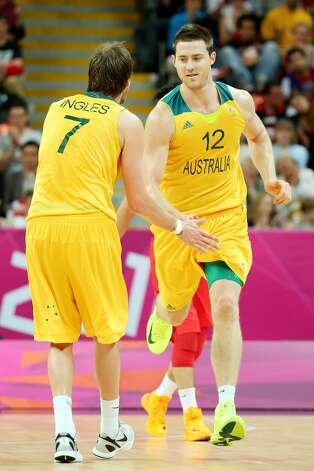 Joe Ingles #7 of Australia and teammate Aron Baynes #12 show camaraderie against China in the second half during the Men's Basketball Preliminary Round match on Day 6 of the London 2012 Olympic Games at Basketball Arena on August 2, 2012 in London, England. (Christian Petersen / Getty Images)