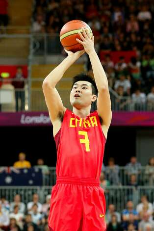 Shipeng Wang #7 of China shoots a three-point shot against Australia in the second half during the Men's Basketball Preliminary Round match on Day 6 of the London 2012 Olympic Games at Basketball Arena on August 2, 2012 in London, England. (Christian Petersen / Getty Images)