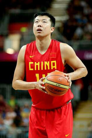 Zhizhi Wang #14 of China prepares to throw a free throw shot against Australia in the second half during the Men's Basketball Preliminary Round match on Day 6 of the London 2012 Olympic Games at Basketball Arena on August 2, 2012 in London, England. (Christian Petersen / Getty Images)