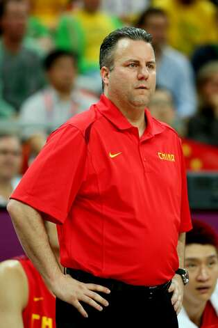 Robert Donewald, Jr. head coach of China watches play against Australia during the Men's Basketball Preliminary Round match on Day 6 of the London 2012 Olympic Games at Basketball Arena on August 2, 2012 in London, England. (Christian Petersen / Getty Images)