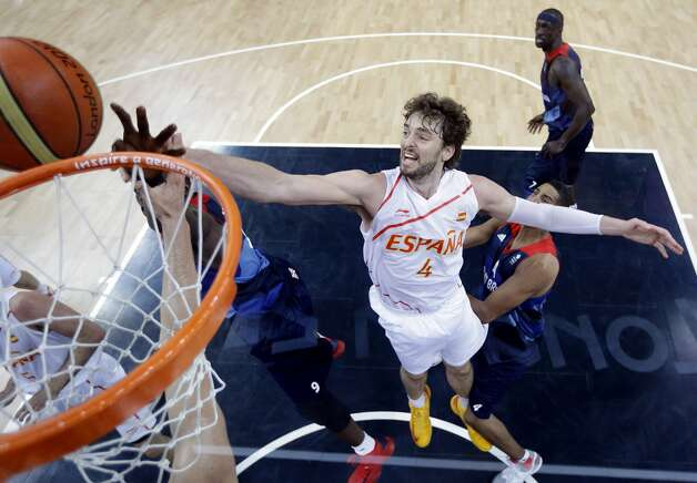 Pau Gasol #4 of Spain reaches over  Luol Deng #9 of Great Britain for a rebound during the Men's Basketball Preliminary Round match between China and Australia on Day 6 of the London 2012 Olympic Games at Basketball Arena on August 2, 2012 in London, England. (Eric Gay / Getty Images)