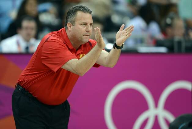 Australian coach Brett Brown gestures during the men's preliminary round Groupe B basketball match Australia vs China of the London 2012 Olympic Games  on August 2, 2012 at the basketball arena in London. (TIMOTHY A. CLARY / AFP/Getty Images)