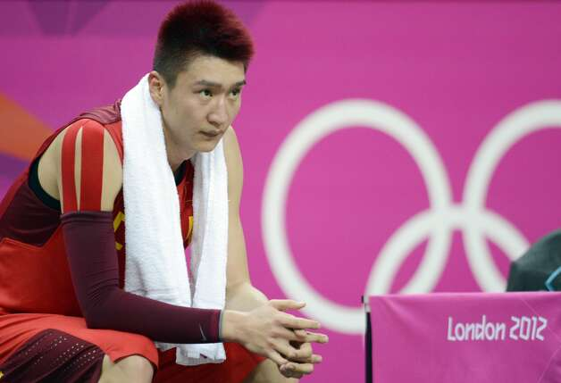 Chinese guard Liu Wei sits on the bench during the men's preliminary round Groupe B basketball match Australia vs China of the London 2012 Olympic Games  on August 2, 2012 at the basketball arena in London. (TIMOTHY A. CLARY / AFP/Getty Images)